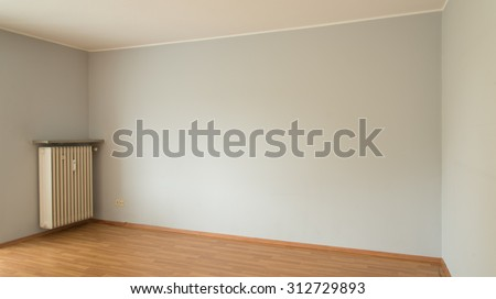 Unfurnished room with gray wall and parquet floor
