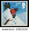 UNITED KINGDOM - CIRCA 2004: A British Used Christmas Postage Stamp showing Santa Claus, circa 2004 - stock photo