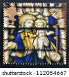 UNITED KINGDOM - CIRCA 2000: A stamp printed in Great Britain shows Virgin and Child Stained Glass Window, St Edmundsbury Cathedral, circa 2000 - stock photo