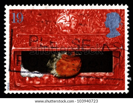 UNITED KINGDOM - CIRCA 1996: a stamp printed in the United Kingdom shows image of a robin sitting in a postbox, circa 1996.