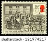 UNITED KINGDOM - CIRCA 1984: A used postage stamp printed in Britain celebrating the Bicentenary of the First Mail Coach Run showing the Holyhead and Liverpool Mails leaving London in 1828, circa 1984 - stock photo
