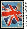 UNITED KINGDOM - CIRCA 2001: An English Use First Class Postage Stamp showing Union Jack Flag, circa 2001 - stock photo