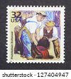 UNITED STATES - CIRCA 1998: a postage stamp printed in USA showing three men throwing alcohol during prohibition, circa 1998. - stock photo