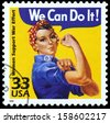 UNITED STATES CIRCA 1999 : Canceled USA. postage stamp showing an image of Rosie The Riveter commemorating the American woman who worked in factories during the World War II, circa 1999.  - stock photo