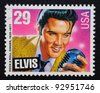 UNITED STATES – CIRCA 1993: postage stamp printed in USA showing an illustration of Elvis Presley holding a microphone, circa 1993. - stock photo