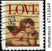 "UNITED STATES OF AMERICA - CIRCA 1995: A stamp printed in the United States of America shows image of an angel and the text ""love"", series, circa 1995 - stock photo"