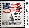 UNITED STATES OF AMERICA - CIRCA 1985: A stamp printed in the USA shows Flag over Capitol, circa 1985 - stock photo