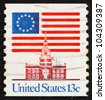 UNITED STATES OF AMERICA - CIRCA 1975: a stamp printed in the USA shows 13-Star Flag and Independence Hall, circa 1975 - stock photo
