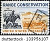 UNITED STATES OF AMERICA - CIRCA 1961: A stamp printed in USA shows The Trail Boss and Modern Range, circa 1961 - stock photo
