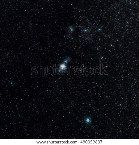 Universe space image: real photo of starry dark night sky with part of the  Orion constellation. The shot was done with total exposure time 23 minutes. Several nebulae are clearly visible.