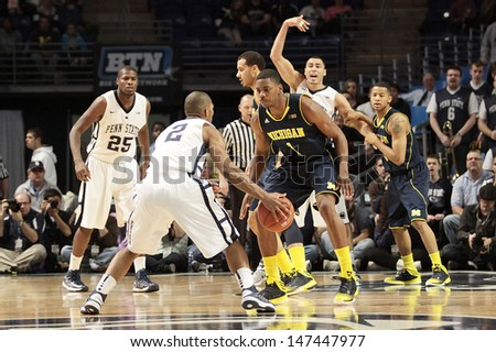 UNIVERSITY PARK, PA - February 27: Penn State's D. J. Newbill is defended by Michigan's Trey Burke at the Byrce Jordan Center February 27, 2013 in University Park, PA