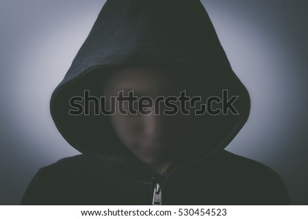 unknown - child with hood and dark unrecognizable face