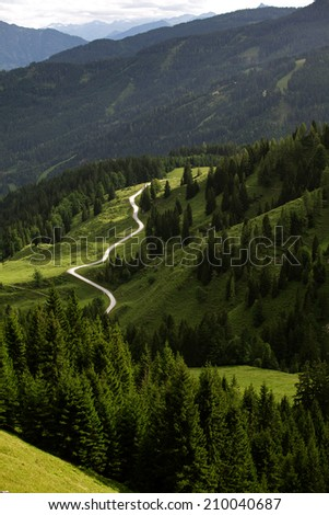 Unpaved Winding alpine road in Europe in summer