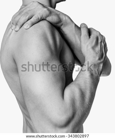 Unrecognizable shirtless man compresses his shoulder, pain in the shoulder. Monochrome image, isolated on a white background