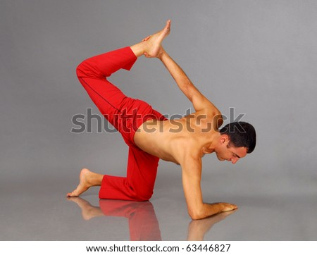 UP - Young man performing Yoga exercises
