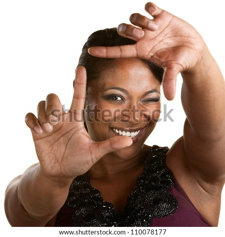 Upbeat Black woman using a framing gesture