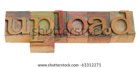 upload concept - word in vintage wooden letterpress printing blocks isolated on white