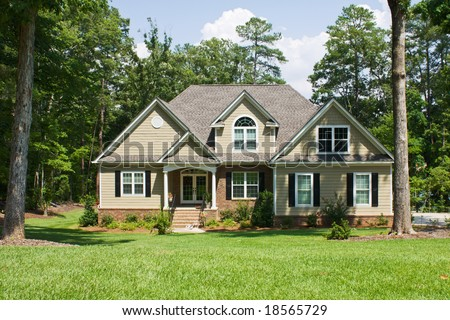 Upscale Home Brick Vinyl Shake Siding Stock Photo 18565729