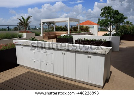 Upscale outdoor cabinets with granite counter top on a rooftop terrace.