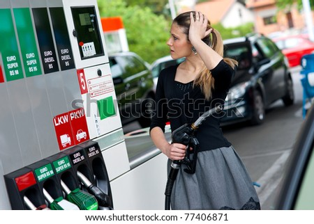 upset woman in gas station