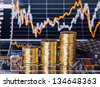 Uptrend stacks coins, dices cube with the word GO and calculator on the financial stock charts as background. Selective focus - stock photo