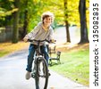 Urban biking - teenage boy and bike in city park - stock photo