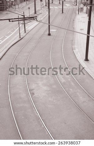 Urban Scene with Tram Lines on Street in Black and White Sepia Tone
