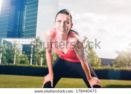 Urban sports - woman running for fitness in the city on beautiful summer day