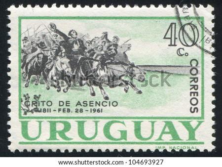 URUGUAY - CIRCA 1961: stamp printed by Uruguay, shows Cavalry Charge, circa 1961