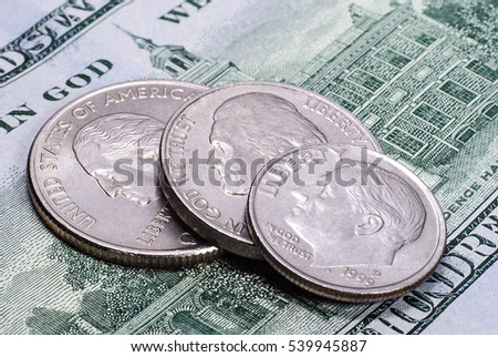 US coins on the hundred dollars banknote
