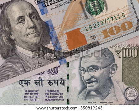 US dollar and indian rupee banknotes, currency exchange, money closeup