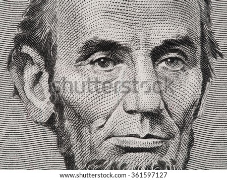US President Abraham Lincoln face on five dollar bill macro, 5 usd, united states money closeup