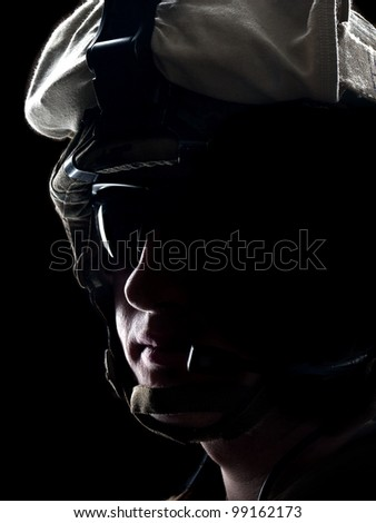 US soldier in the helmet on the black background