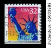 USA-CIRCA 1997: A stamp dedicated to  The Statue of Liberty (Liberty Enlightening the World) is a colossal neoclassical sculpture on Liberty Island in New York Harbor, circa 1997. - stock photo
