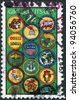 USA - CIRCA 1987: A stamp printed in the USA, dedicated to the 75th anniversary of Girl Scouts, shows the Achievement Badges, circa 1987 - stock photo