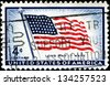 "USA - CIRCA 1957: A stamp printed in United States of America shows Flag ""Old Glory"" (48 Stars), with the inscription ""Long may it wave"", circa 1957 - stock photo"