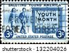 "USA - CIRCA 19: A stamp printed in United States of America shows Girl and Boy carrying Books, Youth of America and ""Youth Month"", circa 1948 - stock photo"