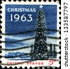USA - CIRCA 1963: A stamp printed in United States of America shows the White House and the National Christmas Tree in Washington DC., circa 1963 - stock photo