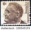 "USA - CIRCA 1965: A stamp printed in USA from the ""Prominent Americans (1st series)"" issue shows president Franklin Delano Roosevelt, circa 1965. - stock photo"