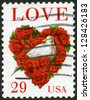 """USA - CIRCA 1994: A stamp printed in USA shows word """"love"""" and dove in a love heart made of roses, circa 1994 - stock photo"""