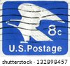 USA- CIRCA 1971: Postage stamp printed in United States of America shows Bald Eagle. USPS Emblem. Horizontal.  Scott Catalog U110 8c bright ultra, blue, circa 1971 - stock photo