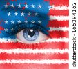 USA flag painted on woman face - stock photo