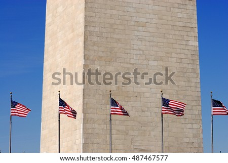 USA flags surround Washington Monument