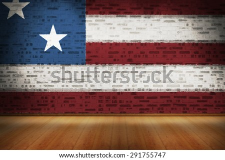 Usa national flag against room with brick wall