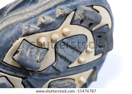 Used baseball cleats against a white background