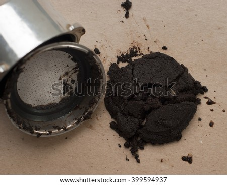 Used coffee grounds with a portafilter