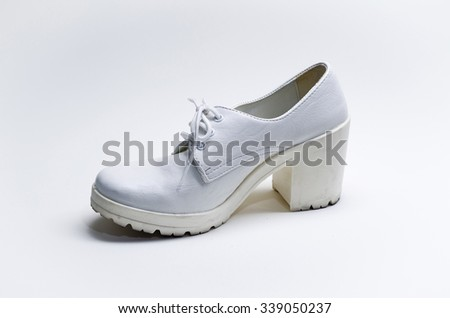 Used white leather woman shoe on white background