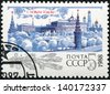 USSR - CIRCA 1987: A cancelled stamp printed in the USSR, shows Kremlin with red star, trees under snow for New Year, circa 1987. Happy New Year 1988 as text. - stock photo
