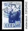 USSR - CIRCA 1959: A post stamp printed in USSR and shows seaman in uniform. Circa 1959. - stock photo