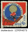 USSR - CIRCA 1966: A stamp printed in the USSR shows hockey player, about 1966 - stock photo